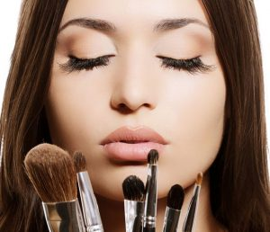 Beautiful-woman-with-makeup-brushes-near-her-face